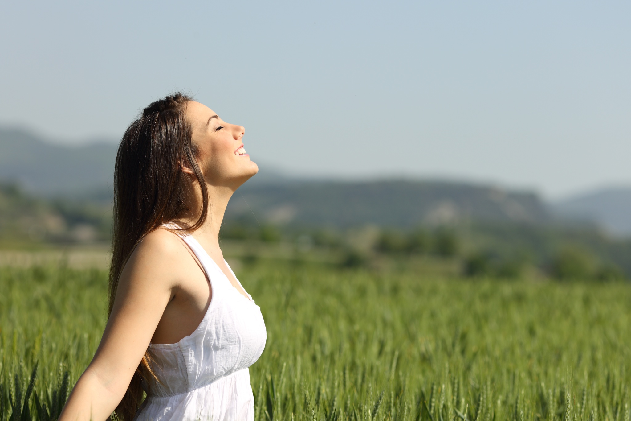 Woman breathing fresh countryside air. Image used in AIR Care Centre Portugal Website