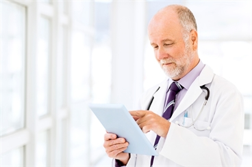 Telehealth/Remote Patient Care: Doctor with tablet.